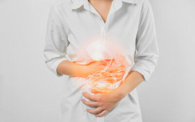 Woman hands touching belly and stomach painful suffering from chronic gastritis on white background. Healthcare concept.
